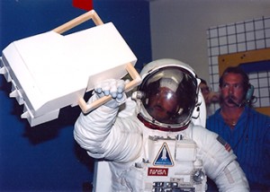 astronaut using mass spectrometer in EVA